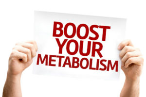 Boost your Metabolism sign being held up